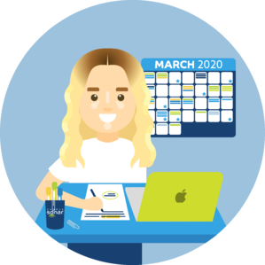 Nicole, a Sonarian, is working at an organized desk with a calendar behind her.